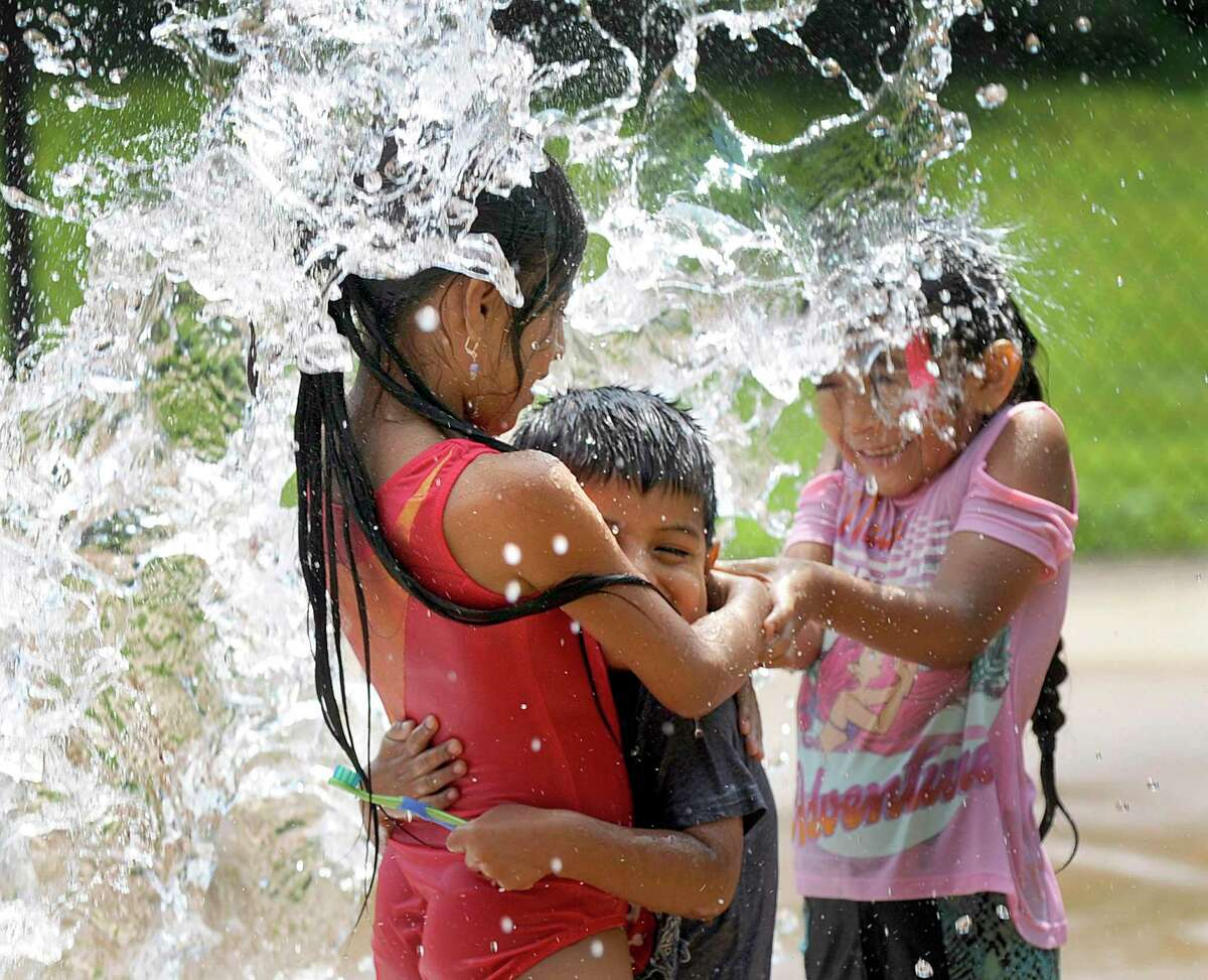 Some Danbury children Ailey get dunked with water at the Highland Avenue Spray Park in Danbury, Tuesday, August 7, 2018.