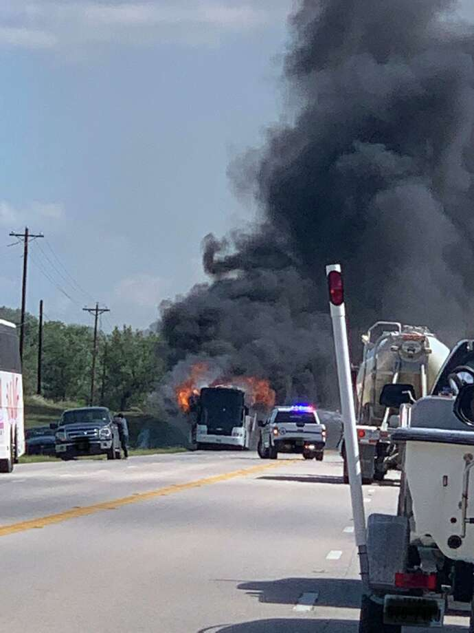 A charter bus headed to San Antonio engulfed in flames Thursday afternoon on U.S. Highway 281 near Ranch Road 1323 in Blanco County, the Blanco County Sheriff's Office confirmed. Photo: Hill Country Scanner