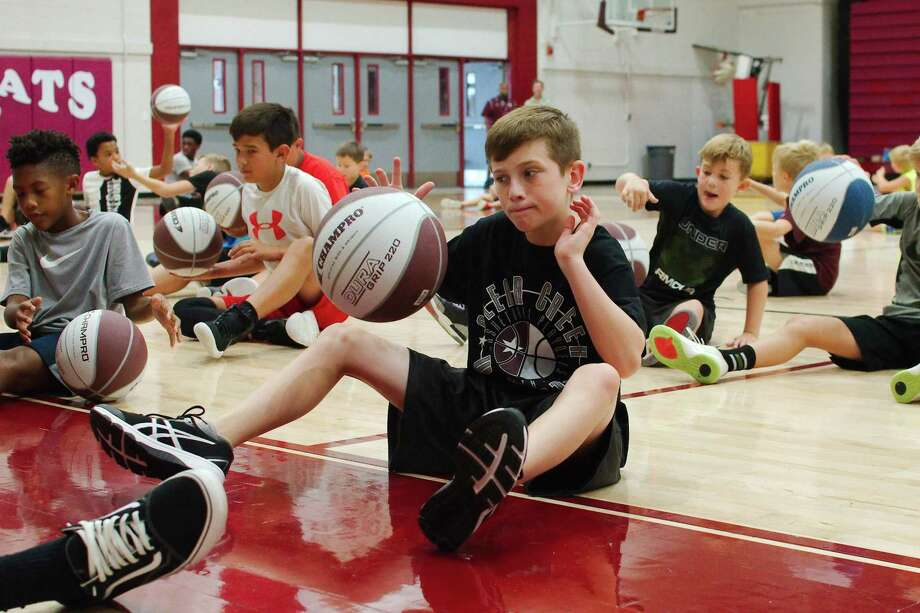 Cian Bennett participates in a dribbling drill at the Clear Creek summer basketball camp. Photo: Kirk Sides / Staff Photographer / © 2019 Kirk Sides / Houston Chronicle