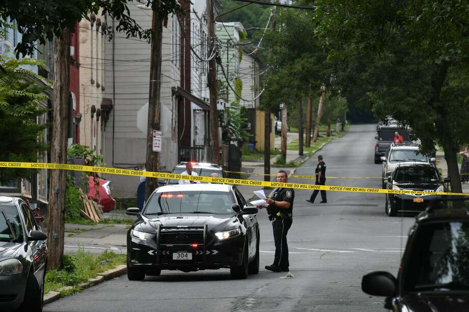 Albany police descended on the city's South End after a 3-year-old boy at a daycare center was hit in the arm by a stray bullet fire during a shootout between masked men who jumped out of a car and other men on a street. Photo: Will Waldron / Times Union