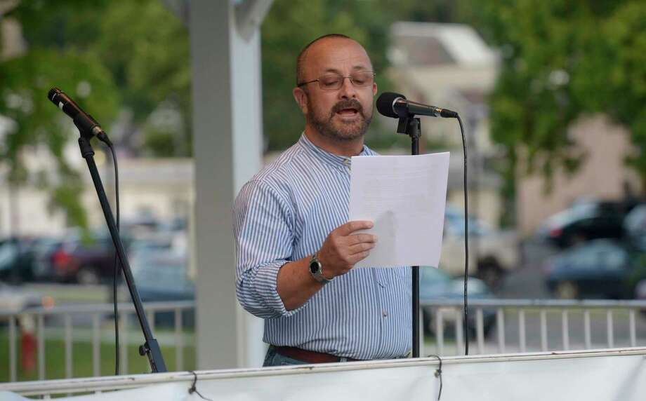 """Alex Villamil, a human rights advocate with Action Together, speaks at a """"Lights for Liberty"""" vigil in Bethel on Friday evening July 12. Photo: H John Voorhees III / Staff Photographer / The News-Times"""