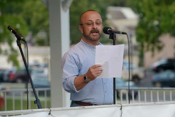 "Alex Villamil, a human rights advocate with Action Together, speaks at a ""Lights for Liberty"" vigil in Bethel on Friday evening July 12."