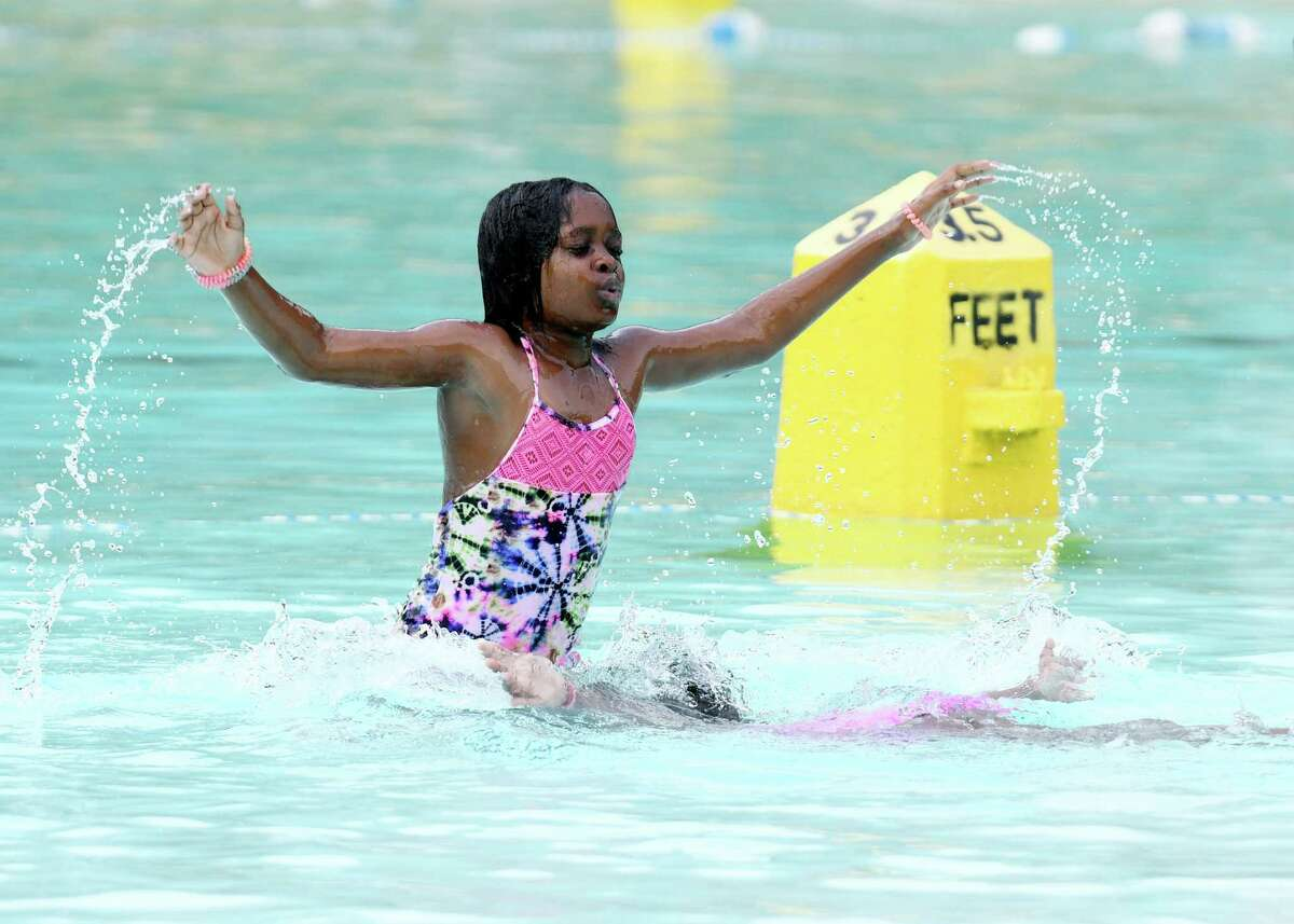 Two girls cool off in Lincoln Park Pool on Thursday, July 18, 2019, in Albany, N.Y. (Catherine Rafferty/Times Union)