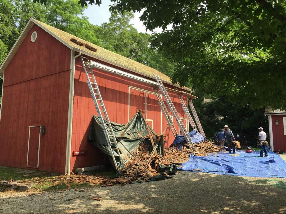 Work continues on replace the Abbott Barn's wood roof at the Wilton Historical Society. Photo: Contributed Photo / Wilton Historical Society / Wilton Bulletin Contributed