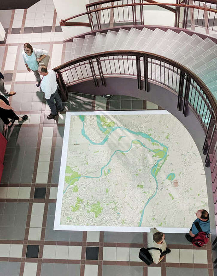 A large map showing the Cahokia Mounds region was placed on the floor of the Administration Building's lobby Wednesday in Edwardsville. The County Board approved a resolution supporting efforts to make Cahokia Mounds part of the National Park System, and also approved $25,000 in funding for the project. On Thursday U.S. Rep. Mike Bost introduced legislation to create a National Historic Park including Cahokia Mounds and other related sites in Illinois and Missouri. Photo: Ed Weilbacher | For The Intelligencer