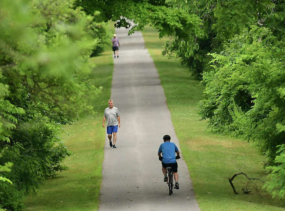 Bikers and walkers take advantage of a cooler day before an expected heatwave weekend on a bike path on Thursday, July 18, 2019 in Niskayuna, N.Y. (Lori Van Buren/Times Union)