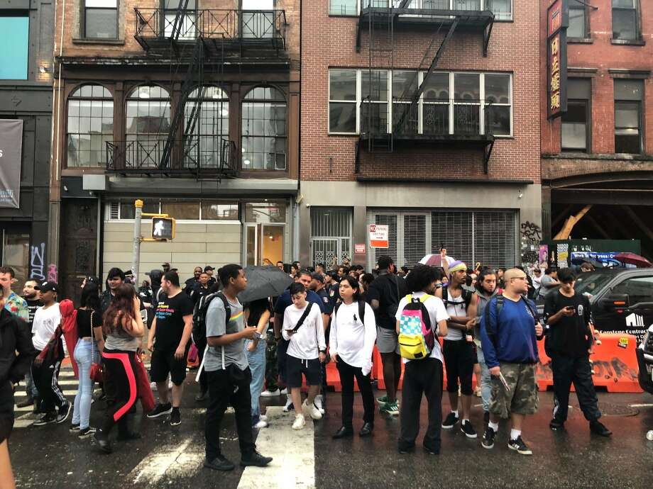 Police shut down a pop-up selling Arizona Iced Tea-branded Adidas sneakers for 99 cents in New York City on Thursday. Photo: Shoshy Ciment/Business Insider