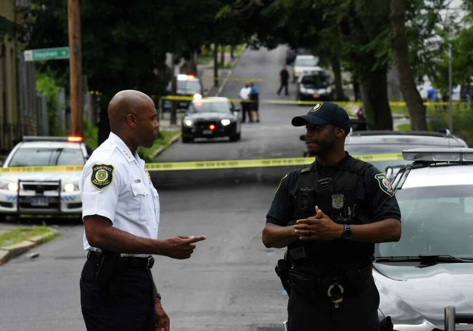 Albany Police Chief Eric Hawkins, left, speaks to an officer at the scene of a shooting on Third Avenue on Thursday, July 18, 2019, in Albany, N.Y. A 3-year-old boy was shot in the arm with a stray bullet fired during a shootout outside of a South End home.  (Will Waldron/Times Union) Photo: Will Waldron, Albany Times Union / 40047449A