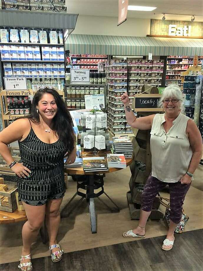 Stevie D'Andrea, left, and Sandy D'Andrea at their new display at the Christmas Tree Shop in Orange. Photo: Contributed Photo