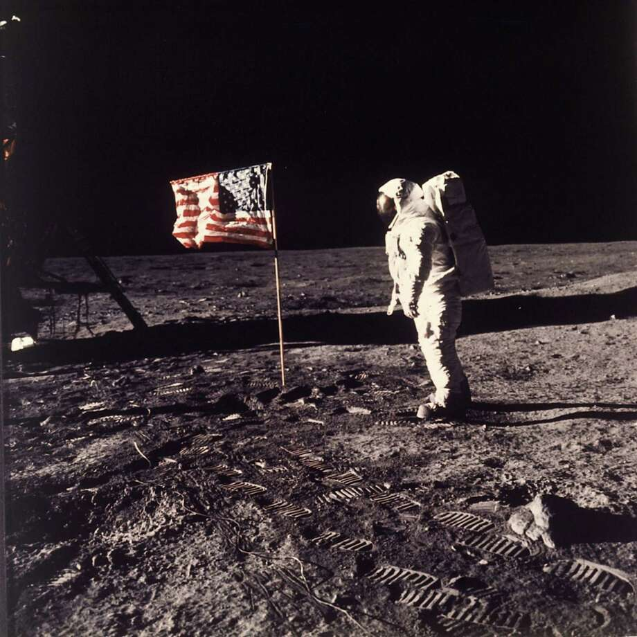 """Astronaut Edwin E. """"Buzz"""" Aldrin Jr. poses for a photograph beside the U.S. flag deployed on the moon during the Apollo 11 mission on July 20, 1969. A reader is proud of San Antonio's role in the moon landing 50 years ago. Photo: NEIL ARMSTRONG /NASA / AP1969"""