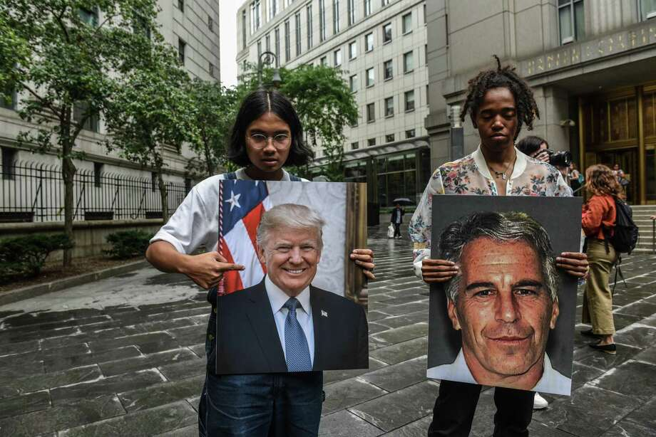 Protesters link Jeffrey Epstein and President Donald Trump earlier this month in New York. Is this friendship what The Donald doesn't want Americans talking about? Photo: Stephanie Keith /Getty Images / 2019 Getty Images