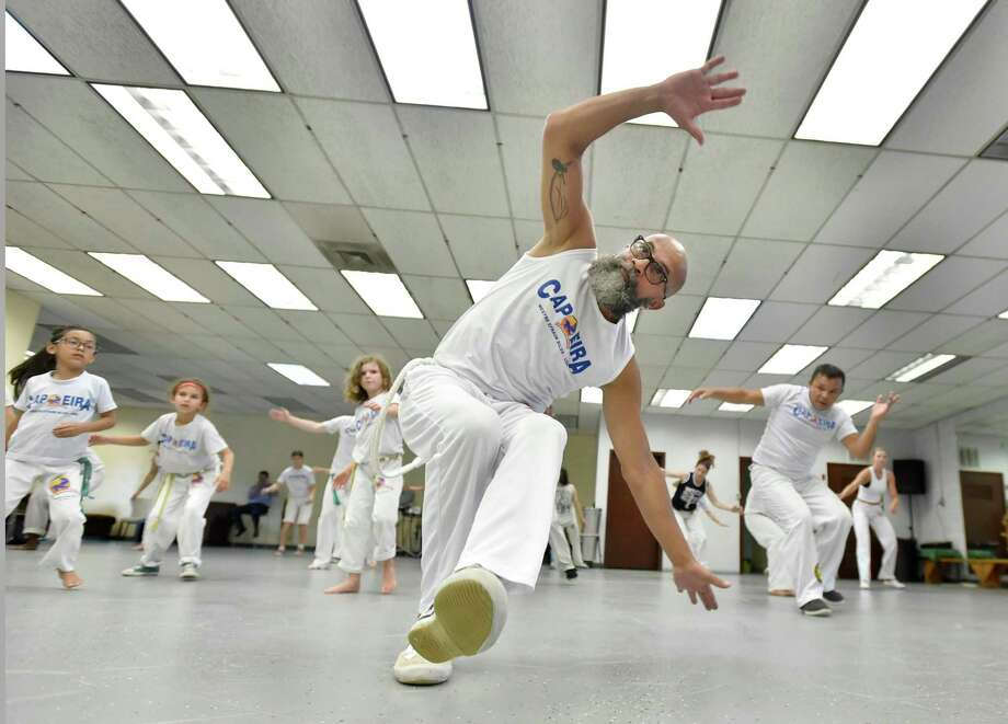 New Haven, Connecticut -Tuesday, July 16, 2019: Efraim Silva, the co-executive director of the Brazilian Fitness Center in New Haven during a class capoeira session. Photo: Peter Hvizdak / Hearst Connecticut Media / New Haven Register