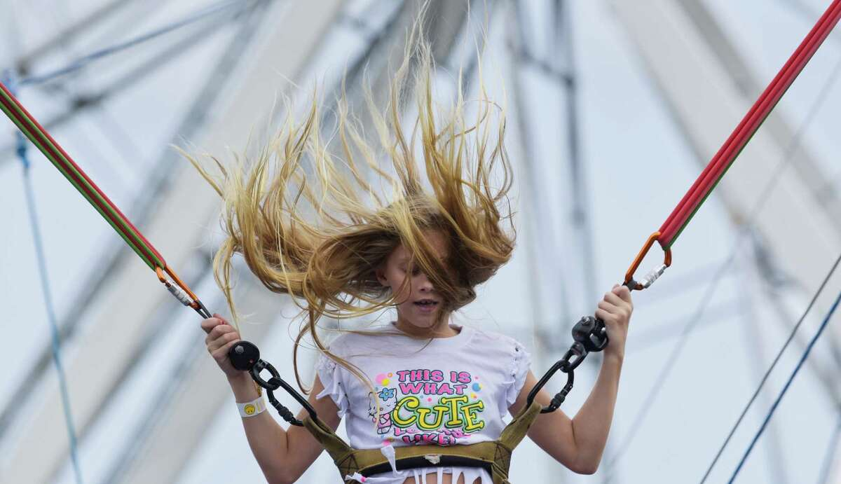 Cianna Partak's hair flies around as she plays on the Bungee Bounce ride on the final day of the Altamont Fair on Sunday, Aug. 19, 2018, in Altamont, N.Y. (Paul Buckowski/Times Union)