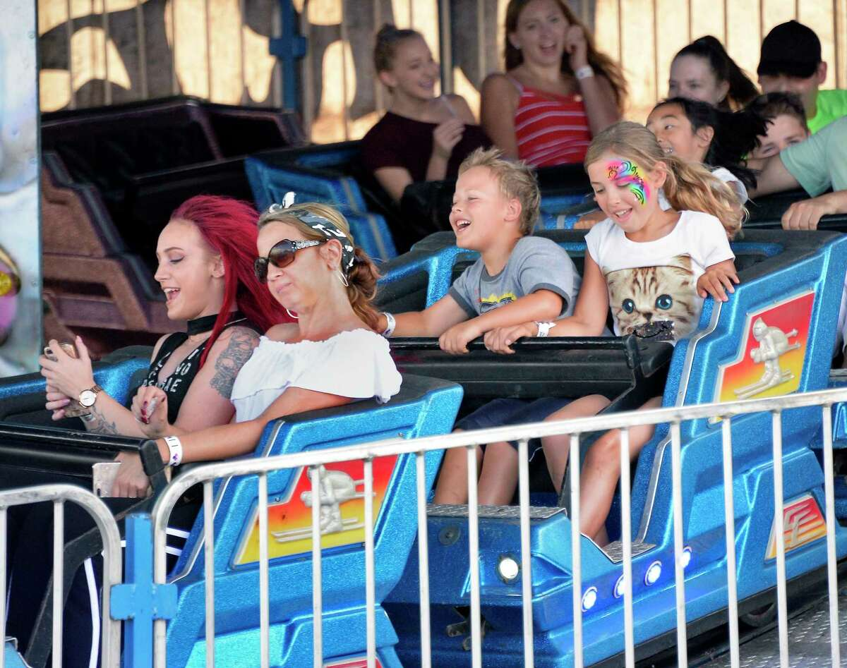 Braving the Himalaya ride are from left, Alyssa Hyney and her mother Dana Holdridge, both of Little Falls, and brother and sister Brenden and Waverly Candiloro of Altamont as the Altamont Fair opens Tuesday August 14, 2018 in Altamont,NY. (John Carl D'Annibale/Times Union)