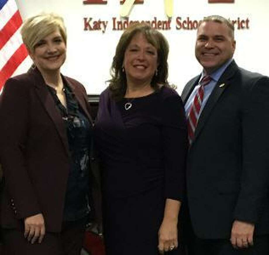 Olga Leonard, center, is the namesake for an elementary school opening in August in the Katy Independent School District. The longtime district educator is flanked Courtney Doyle, school board president, and Ken Gregorski, district superintendent. Photo: Katy ISD / Katy ISD