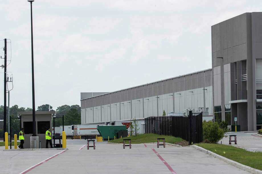 Security personnel work the gates at the 728,000-square-foot C&S Wholesale Grocers' Grocers Supply building is shown on Wednesday, July 17, 2019, in Houston. Photo: Brett Coomer, Houston Chronicle / Staff Photographer / © 2019 Houston Chronicle