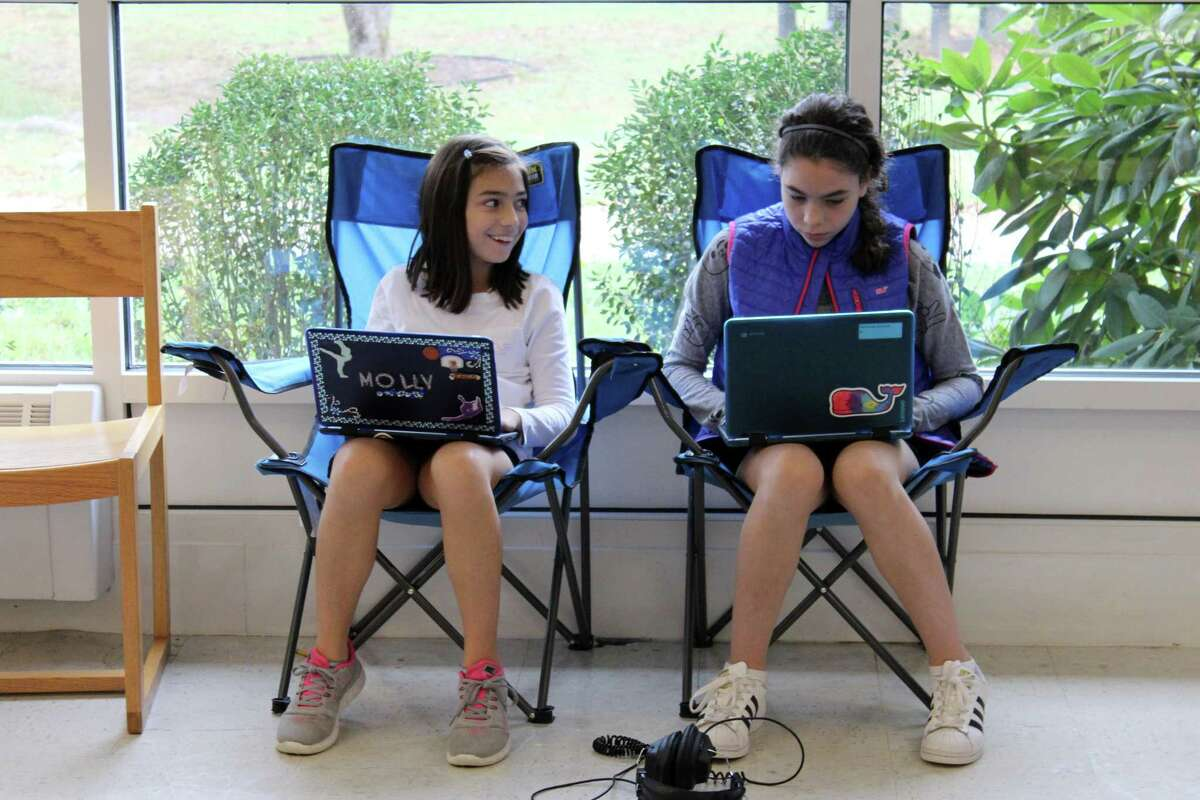 Students on their Chromebooks in the Middlebrook School Library.