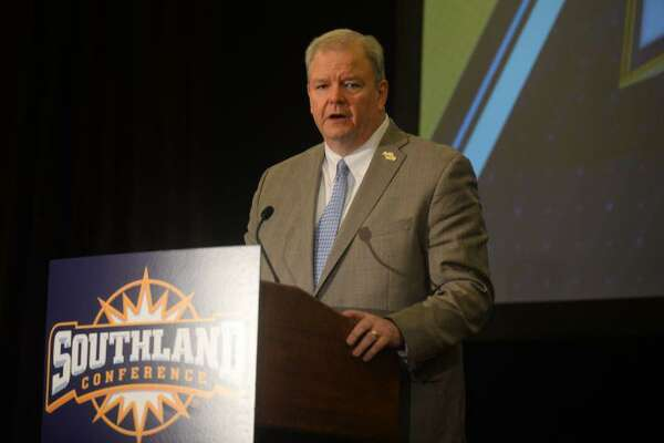 Commissioner Tom Burnett speaks during Southland Conference Media Day at the Hilton Houston Post Oak Hotel by the Galleria in Houston. Photo taken on Thursday, July 18, 2019 by Matt Faye/The Enterprise.