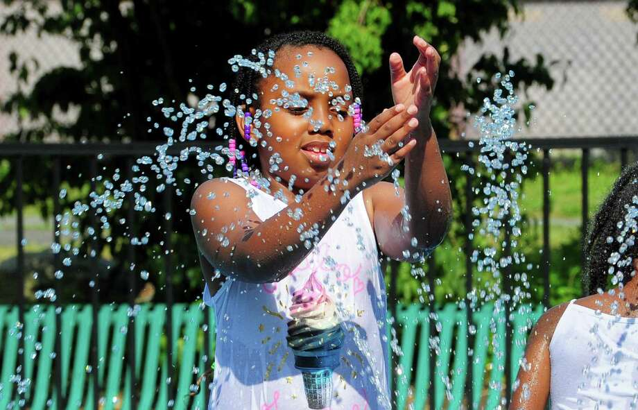 Diamond Epps, 7, of Bridgeport, plays at the splash pad at Longbrook Park in Stratford, Conn., on Thursday July 5, 2019. Photo: Christian Abraham / Hearst Connecticut Media / Connecticut Post