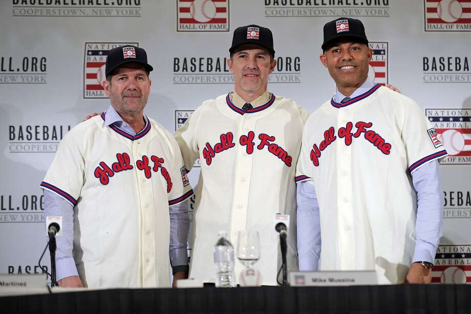 FILE - In this Jan. 23, 2019, file photo, Baseball Hall of Fame inductees Edgar Martinez, left, Mike Mussina, center, and Mariano Rivera, right, pose for photographs during news conference in New York. Baseball Hall of Fame induction ceremonies are on Sunday, July 21, 2019, in Cooperstown, N.Y. (AP Photo/Frank Franklin II) Photo: Frank Franklin II, Associated Press