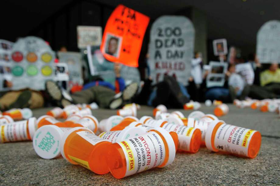 In this April 5, 2019, file photo, containers depicting OxyContin prescription pill bottles lie on the ground in front of the Department of Health and Human Services' headquarters in Washington as protesters demonstrate against the FDA's opioid prescription drug approval practices. Photo: Patrick Semansky / Associated Press / Copyright 2019 The Associated Press. All rights reserved.