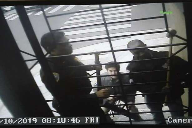In this May 10, 2019, image taken from video provided by Bryan Carmody San Francisco police armed with sledgehammers execute a search warrant at journalist Bryan Carmody's home in San Francisco. Efforts to unseal warrant materials used to search the home and office of freelancer Carmody in May were set back again Friday, July 12, 2019, after a San Francisco judge said he needed more information before making a decision. (Bryan Carmody/@bryanccarmody via AP)