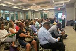 On Wednesday, Ed Fleming, president of the east region of Walton Development Group, explains to Prince George's County, Maryland, residents what an Amazon logistics center would look like there.