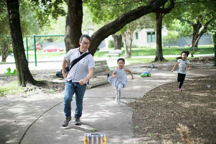 "Hideaki Takahashi plays tag with his daughter Nao Takahashi, 5, at the Old Braeswood Park on Wednesday, May 22, 2019, in Houston. ""There is an inclusive atmosphere,"" he said of the neighborhood, where his family has lived for three years. He supported the Old Braeswood Property Owners Association's efforts to remove an unenforced restriction on the race of people who could live there."
