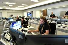 Security specialist Mary Landez speaks on the phone in the USAA Unified Command Center, which monitors and responds to storms, power outages and other events, on Thursday, July 18, 2019