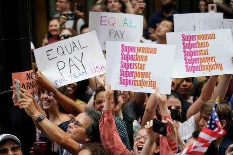 In Manhattan this month, fans waved signs supporting equal pay during the Ticker Tape Parade for the U.S. Women's National Team.