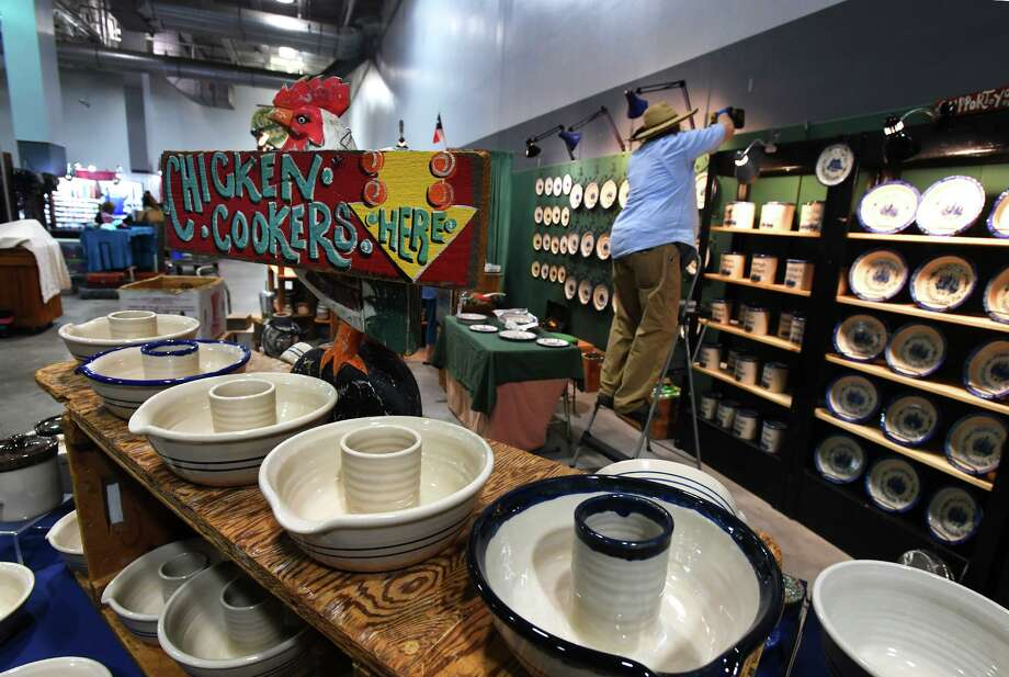 Clarence Brown arranges pottery at his booth during Thursday's setup for The Peddler Show at Ford Park. The Three-day show starts Friday and offers goods, foods and wares  Photo taken Thursday, 7/18/19 Photo: Guiseppe Barranco/The Enterprise, Photo Editor / Guiseppe Barranco ©