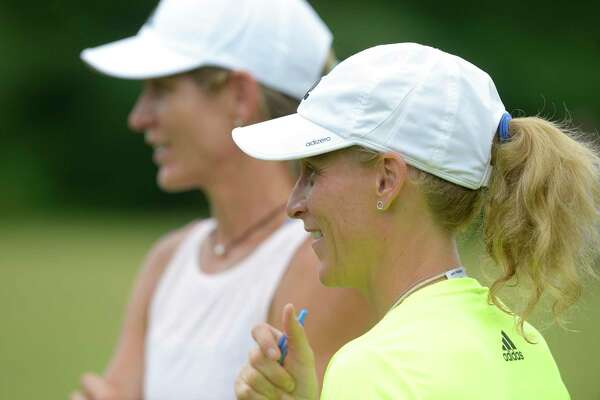 Kristine Lilly, right, and Jodi Sorrells watche a game during the final day of the Kristine Lilly Wilton Soccer Camp on Thursday, July 18, 2019, in Wilton, Conn. Sorrells is an asistant at the soccer camp and has been friends with Lilly since middle school in Wilton.