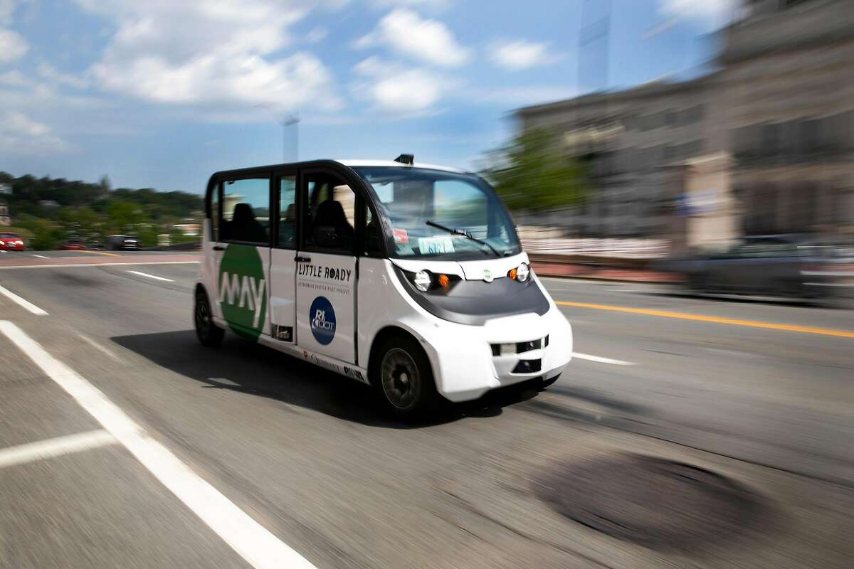 FILE -- A May Mobility autonomous shuttle drives on the city streets near the Rhode Island state house, in Providence, R.I., May 20, 2019. Ford and other companies say the industry overestimated the arrival of autonomous vehicles, which still struggle to anticipate what other drivers and pedestrians will do. (Kayana Szymczak/The New York Times)