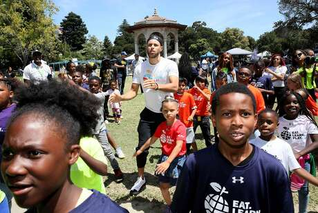 Golden States Warriors guard Stephen Curry dances with his daughter Riley, who turns 7 this week, during the launch of Eat, Play, Learn, at Lakeside Park at Lake Merritt in Oakland, Calif., on Thursday, July 18, 2019. Curry and his wife Ayesha started the new foundation that focuses on providing support for the 3 basic ingredients of a healthy childhood. They are partnering with Oakland Parks and Recs and other local entities to provide services for underserved Oakland children.