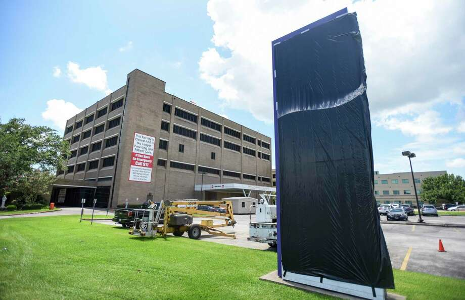 A tarp lays over a sign for CHRISTUS Southeast Texas St. Mary on Thursday afternoon. The hospital is closing with its last day being Thursday. Photo taken on Thursday, 07/18/19. Ryan Welch/The Enterprise Photo: Ryan Welch / Ryan Welch/The Enterprise / © 2019 Beaumont Enterprise