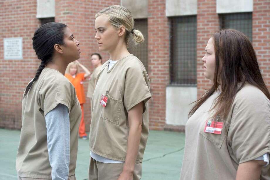 "Maria (Jessica Pimentel, left) confronts Piper (Taylor Schilling) in ""Orange Is the New Black"" MUST CREDIT: JoJo Whilden, Netflix Photo: JoJo Whilden / Netflix"