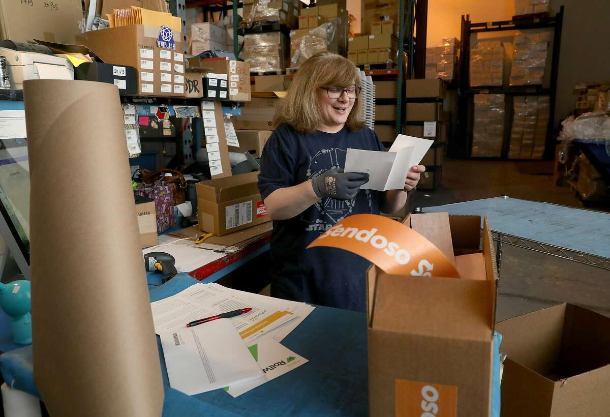 Shipper Anna Garcia packaging items with handwritten notes at the shipping department of Sendosa on Wednesday, June 5, 2019 in Union City, Calif. A factory/mailing facility run by Sendoso sends packages of personalized swag with handwritten notes on behalf of business clients.