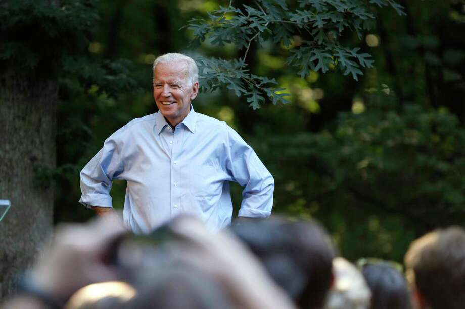 Former Vice President and Democratic presidential candidate Joe Biden arrives to speak at a house party at former Agriculture Secretary Tom Vilsack's house, Monday, July 15, 2019, in Waukee, Iowa. (AP Photo/Charlie Neibergall) Photo: Charlie Neibergall, STF / Associated Press / Copyright 2019 The Associated Press. All rights reserved