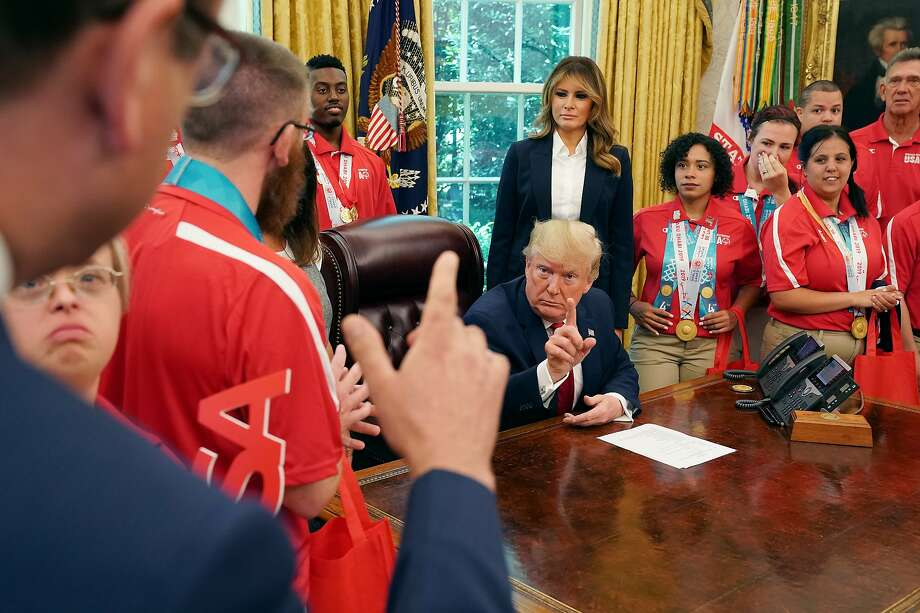 U.S. President Donald Trump (C) answers questions from ABC News' Jonathan Karl (L) as Trump and first lady Melania Trump host members of the United States Special Olympics World Games team in the Oval Office at the White House July 18, 2019 in Washington, DC. During the photo opportunity, Trump said that he wished his supporters had not chanted, 'Send her back,' in reference to Rep. Ilhan Omar (D-MN) during a political rally Wednesday in North Carolina. Photo: Chip Somodevilla, Getty Images