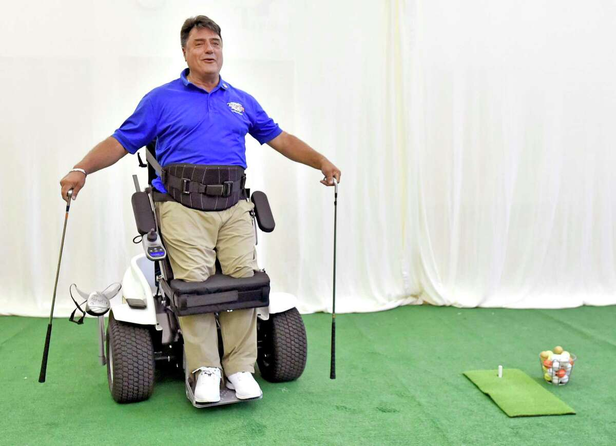 Anthony Netto, of Nevada, a former member of the South African Special Forces attached to the British Royal Marines who was shot and paralyzed in 1991 during the Gulf War, and is the founder of the Stand Up And Play Foundation and co-inventor of the Paramobile-Paragolfer, demonstrates the moving standing therapy mobile device Thursday that was recently acquired through donations by the Gaylord Hospital adaptive sports program in Wallingford. The Paramobile gives wheelchair users mobility and a standing therapy, providing a better quality of life. It functions as a rehabilitative aid, helps improve circulation, and respiration, reduces muscle spasticity, provides pressure relief on organs and minimizes occurrence of pressure sores.