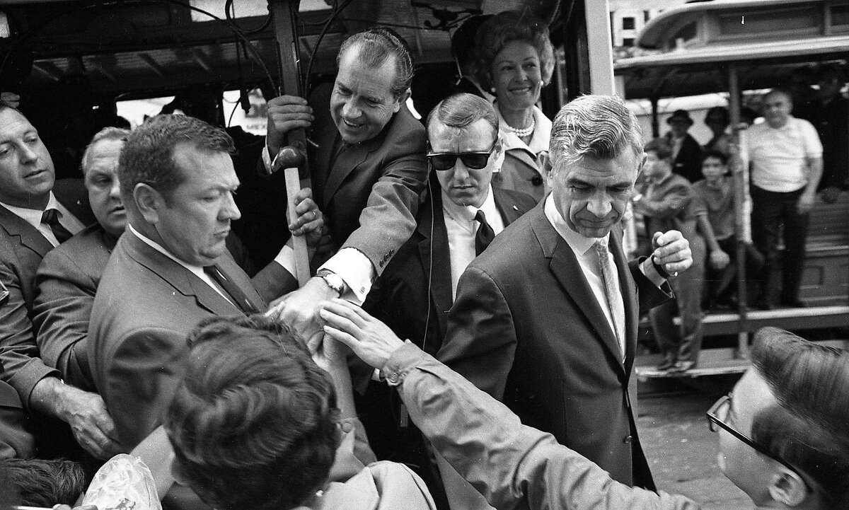 President Richard Nixon visits San Francisco and stays at the St. Francis, July 23, 1969. He and wife Pat Nixon get onto a Cable Car.