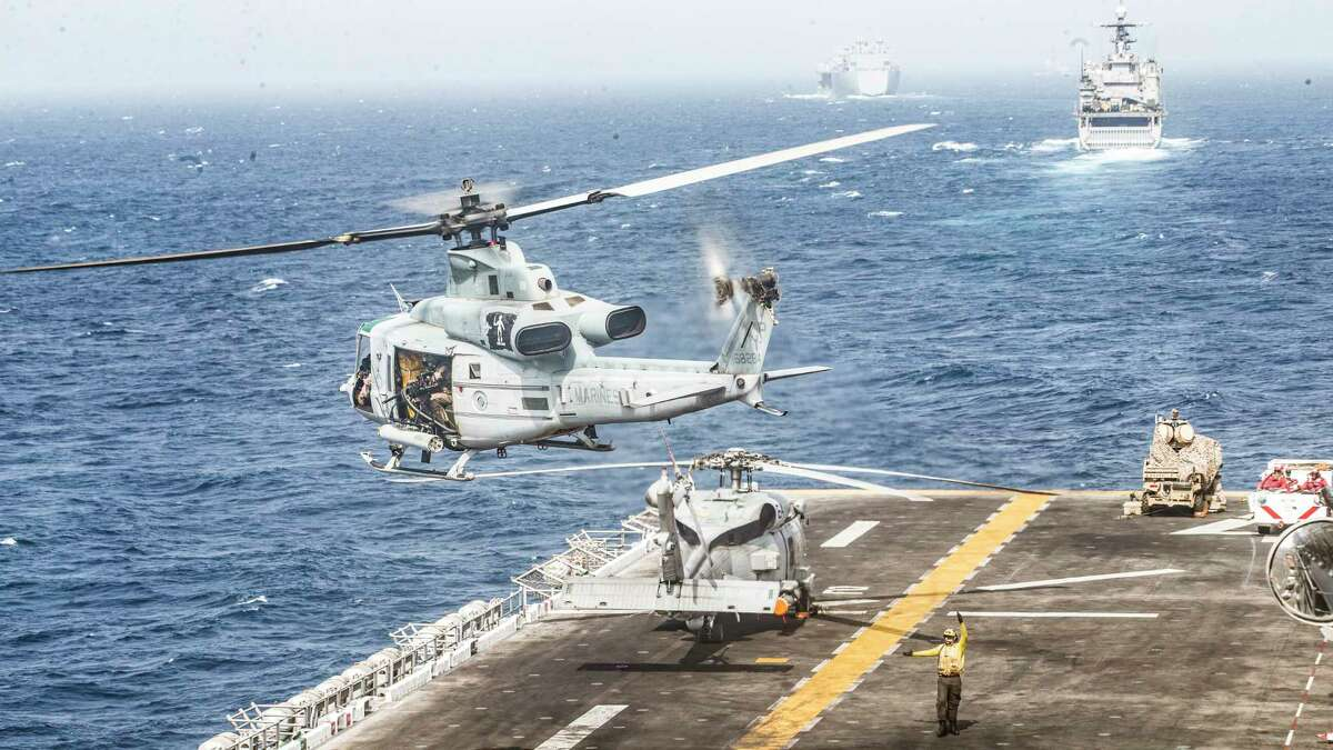 In a photo from the U.S. Marine Corps, a helicopter takes off from the flight deck of the Boxer, an amphibious assault ship, in the Strait of Hormuz, July 18, 2019. President Donald Trump said Thursday that the American military shot down an Iranian drone that threatened the Boxer. It was unclear if the Iranian drone was armed. (Lance Cpl. Dalton Swanbeck/U.S. Marine Corps via The New York Times) -- FOR EDITORIAL USE ONLY