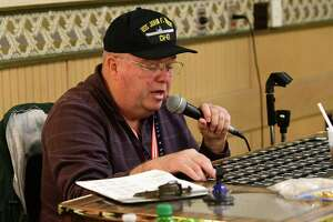 Caller Rich Tidd confirms the Bingo balls after someone claimed Bingo as people play Bingo at the American Legion Post No. 1231 on Wednesday, May 15, 2019 in East Greenbush, N.Y. (Lori Van Buren/Times Union)