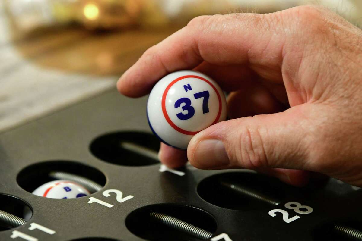 Caller Rich Tidd draws the N-37 ball as people play Bingo at the American Legion Post No. 1231 on Wednesday, May 15, 2019 in East Greenbush, N.Y. (Lori Van Buren/Times Union)
