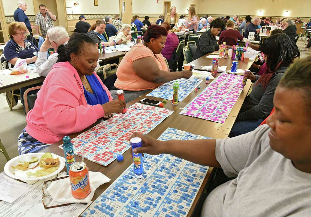 Long time Bingo playing sisters Myra Mayweather, left, Janice Ellis, center, and Mary Harris, bottom right, all from Albany, play Bingo at the American Legion Post No. 1231 on Wednesday, May 15, 2019 in East Greenbush, N.Y. (Lori Van Buren/Times Union)