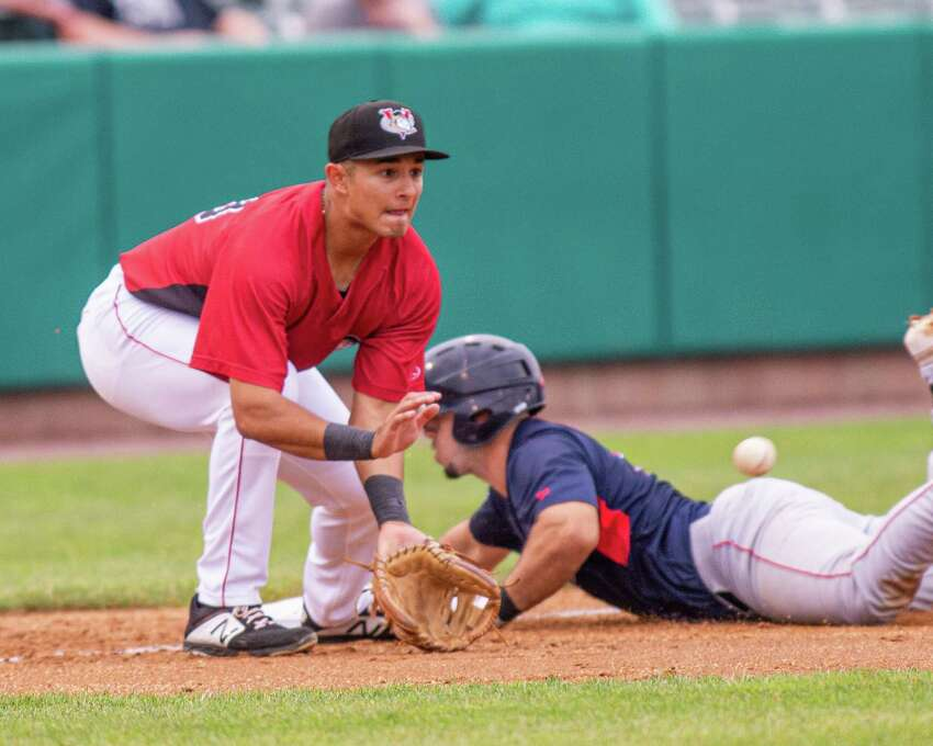 Tri-City ValleyCats third baseman Bria Arias waits for the throw as Lowell Spinners shortstop Cameron Cannon slides safely into the base during a game at the Joseph L. Bruno Stadium in Troy NY on Thursday, July 18, 2019 (Jim Franco/Special to the Times Union.)