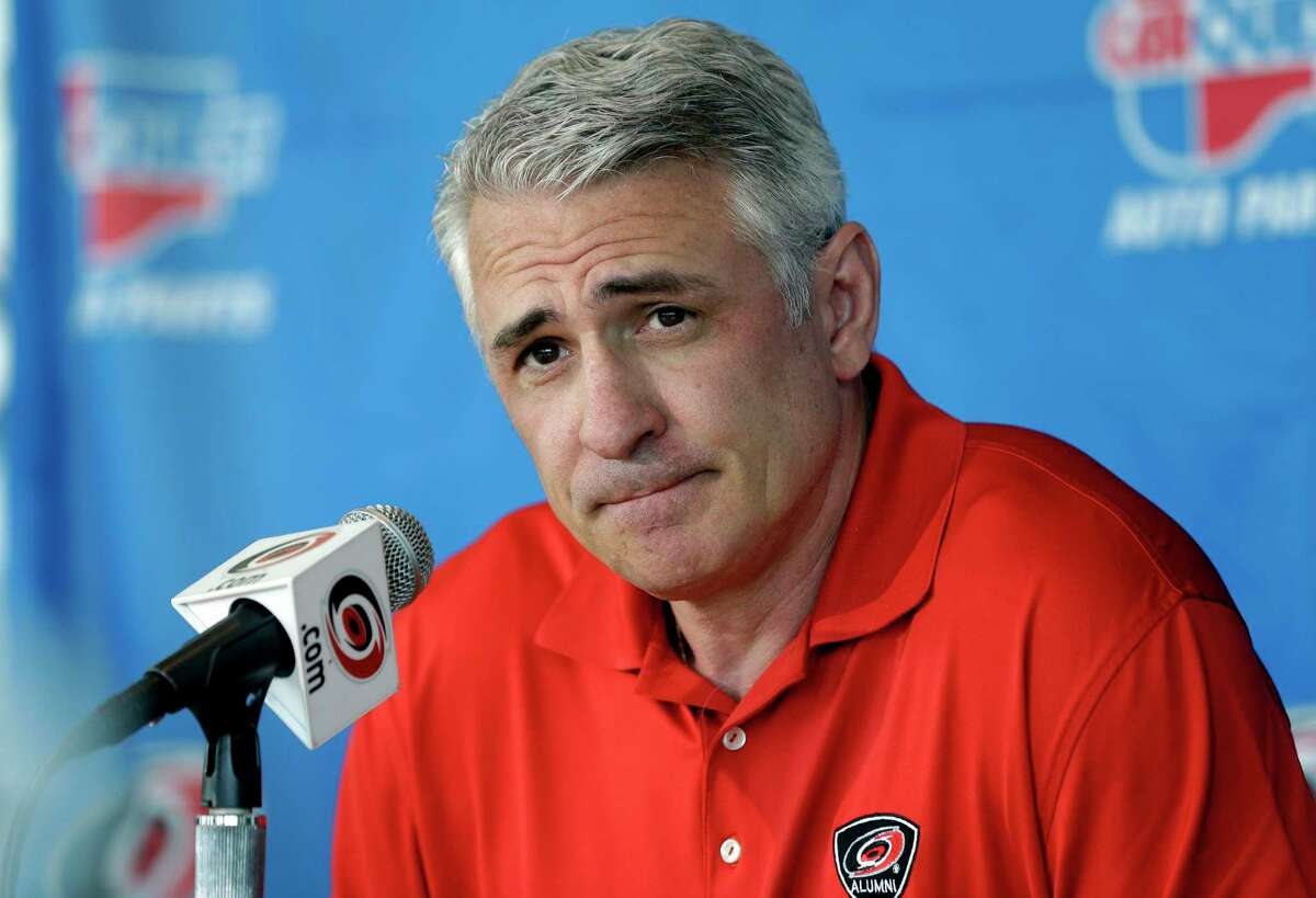 FILE - In this May 5, 2014, file photo, Ron Francis, at the time the general manager of the Carolina Hurricanes, takes questions from members of the media during a news conference in Raleigh, N.C. Seattlea€™s NHL expansion team is close to an agreement with Francis to become its first general manager, a person with direct knowledge tells The Associated Press. The person spoke on condition of anonymity Tuesday, July 16, 2019, because the team had not made an announcement. The expansion Seattle franchise is set to begin play in the 2021-22 season as the NHLa€™s 32nd team.(AP Photo/Gerry Broome, File)