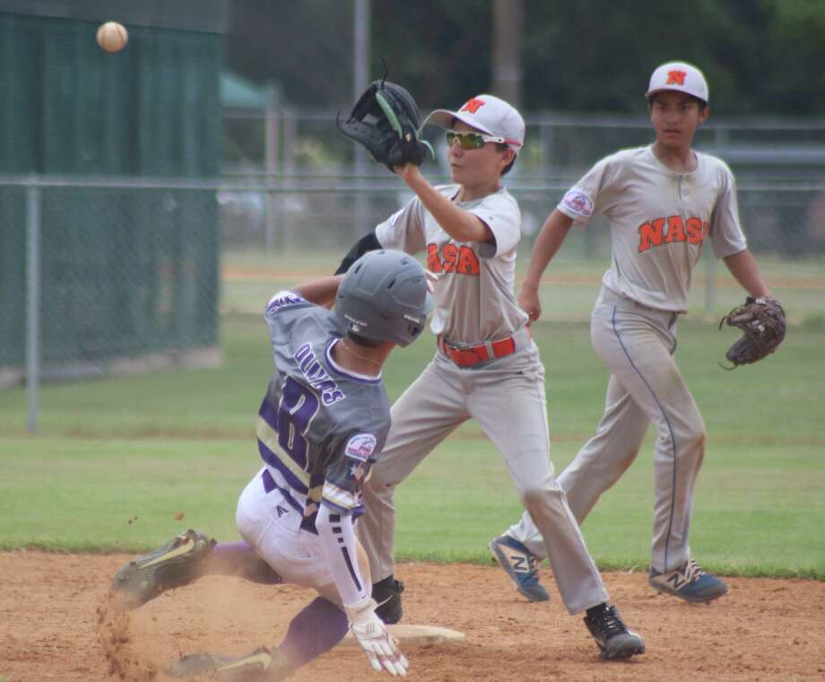 NASA-Orange second baseman Reese Rothermel waits for the throw from his catcher as a San Benito runner slides into second base with the steal in the third inning Thursday when the team scored two of their five runs. Photo: Robert Avery