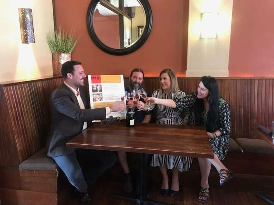 """Opera Edwardsville founder and Artistic Director Chase Hopkins, left, makes a Champagne toast to Opera Edwardsville's 2019 Season with restaurateurs, left to right, Jeff Thomas, owner of Bigelo's Bistro; Megan Pashea, who, along with her husband, Adam, owns 1818 Chophouse; and, Kari McGinness, who along with her husband, Keith, owns Cleveland Heath. Not pictured are OE restaurant/wine shop/brewery partners Mike Shannon's, owned by Shannon and his daughter, Pat Shannon-VanMatre; Bin 51, owned by Wally Osika; and, Recess Brewing Co., owned by Matt Flach. Opera Edwardsville's restaurant/wine shop/brewery partners are offering """"Pre-Opera Menus"""" before each of Opera Edwardsville's season concerts. Bin 51 and Recess Brewing will have their own offerings in beer, wine, liquor and spirits specials. Photo: Jill Moon The Edge"""