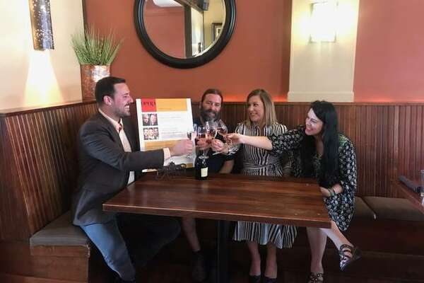 "Opera Edwardsville founder and Artistic Director Chase Hopkins, left, makes a Champagne toast to Opera Edwardsville's 2019 Season with restaurateurs, left to right, Jeff Thomas, owner of Bigelo's Bistro; Megan Pashea, who, along with her husband, Adam, owns 1818 Chophouse; and, Kari McGinness, who along with her husband, Keith, owns Cleveland Heath. Not pictured are OE restaurant/wine shop/brewery partners Mike Shannon's, owned by Shannon and his daughter, Pat Shannon-VanMatre; Bin 51, owned by Wally Osika; and, Recess Brewing Co., owned by Matt Flach. Opera Edwardsville's restaurant/wine shop/brewery partners are offering ""Pre-Opera Menus"" before each of Opera Edwardsville's season concerts. Bin 51 and Recess Brewing will have their own offerings in beer, wine, liquor and spirits specials."